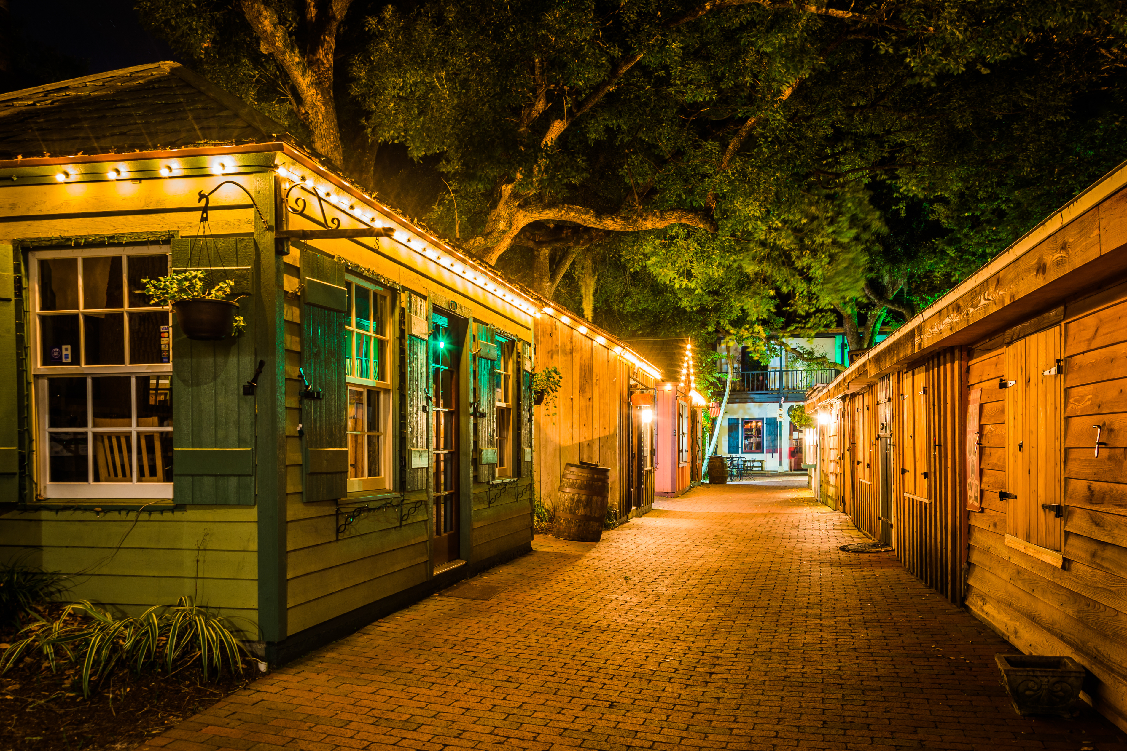 Narrow brick alley at night, in St. Augustine, Florida.